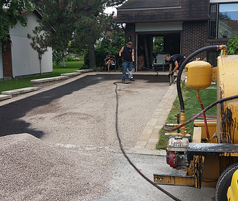 Hand-held asphalt distributor equipment available for small spaces and smaller driveway construction.